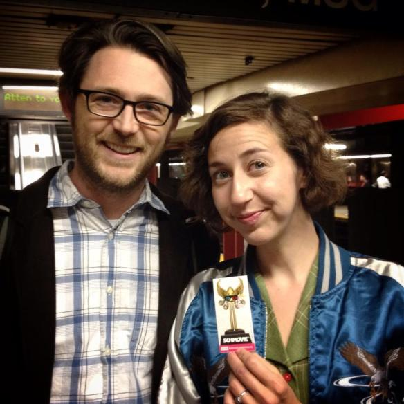 Kristen Schaal schows off her new Schmovie schticker.