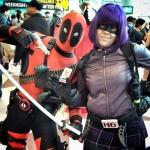Deadpool and Hitgirl schow off their Schmovie sticker.